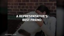 Alexandria Ocasio-Cortez Plays With Dog On The Campaign Trail