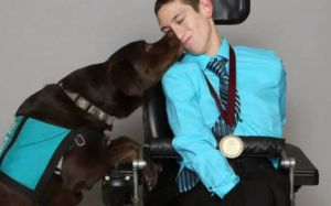 Disabled Young Man & His Service Dog Bring Comfort To Hospice Patients