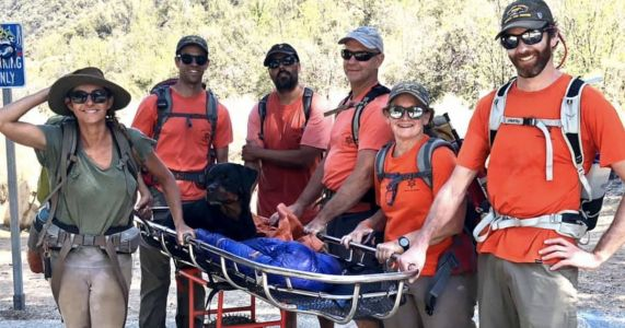 Rescuers Carry Injured 80-Pound Rottweiler To Safety During Hiking Trip